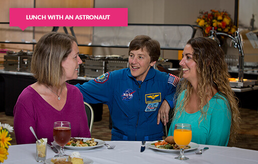 Female astronaut with ladies at lunch