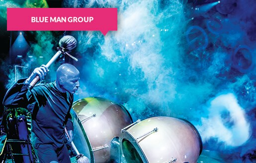 Blue Man Group with drums on stage